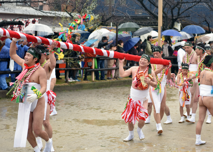 Participants of Naked Man festival are carrying a big ceremonial bamboo pole wrapped in long pieces of cloth. Sake helps them to stay warm during cold winter weather.